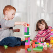 Stock Photo: Kids playing with wooden blocks