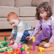 Stock Photo: Kids playing with blocks