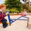Kids playing on sandpit toys — Stock Photo