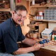 Stock Photo: Msitting at workbench in workshop