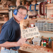 Senior man in workshop not listening — Stock Photo