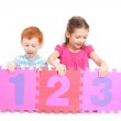 Kids counting 123 with number tiles — Stock Photo