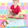 Boy child drawing on kids mat — Stock Photo
