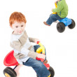 Boys riding kids tricycles — Stock Photo #12743599