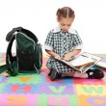Girl student studying school reading homework book — Stock Photo