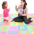 Stock Photo: Girl learning phonics alphabet abc