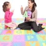 Girl learning phonics alphabet abc — Stock Photo #12743626