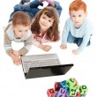 Children learning with kids alphabet blocks and computer — Stock Photo