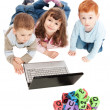 Stock Photo: Children learning with kids alphabet blocks and computer
