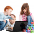 Children learning reading with kids blocks and computer — Stock Photo #12743735