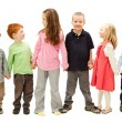 Group of happy kids holding hands — Stock Photo #12743915