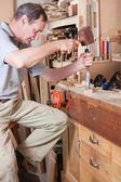 Chiseling on workbench — Stock Photo