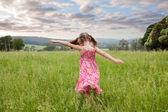 Girl running through long grass — Stock Photo