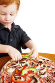 Boy making pizza — Stock Photo