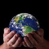 For God so loved the world... God holding world with cross — Stock Photo