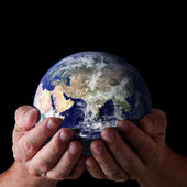 Holding world in hands — Stock Photo