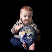 Boy holding his future world — Stock Photo