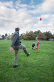 Kids playing sport with grandfather — Stock Photo