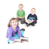 Happy kids reading books — Stock Photo