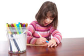 Girl drawing with colored markers — Stock Photo