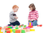 Kids playing with colorful blocks — Stock Photo