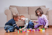 Preschoolers playing with blocks — Stock Photo