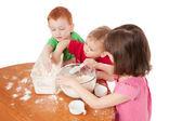Preschooler kids making mess in kitchen — Stock Photo