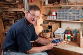 Man sitting at workbench in workshop — Stock Photo