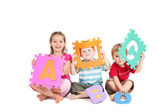 Kids having fun learning alphabet ABC — Stock Photo