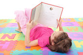 Girl child reading book — Stock Photo