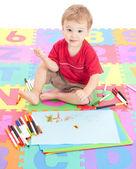 Boy child drawing on kids mat — Stock Photo