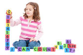 Girl counting numbers with kids blocks — Stock Photo