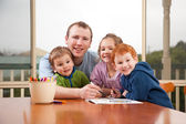Dad coloring kids pictures with children — Stock Photo