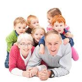 Grandparents with grandchildren — Stock Photo