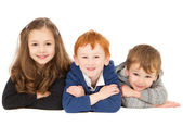 Happy smiling children laying in group — Stock Photo