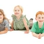 Happy smiling group of kids on floor — Stock Photo