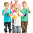 Stock Photo: Group of children with kids paint brushes