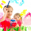 Kids painting picture on glass — Stock Photo