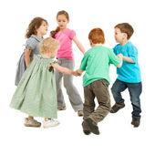 Happy kids playing circle game — Stock Photo