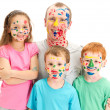 Family of kids and dad with messy painted faces — Stock Photo #14416427