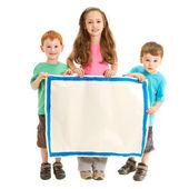 Happy kids holding blank sign — Stock Photo