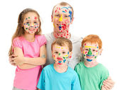 Family of kids and dad with messy painted faces — Stock Photo