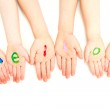 Kids hello welcome painted on hands — Stock Photo