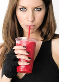 Girl sips Red Smoothie Raw Food Fruit Strawberry Frozen Drink — Stock Photo