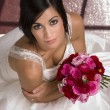 Bride Seated with Bouquet — Stock Photo