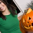 Woman with Halloween pumpkin — Stock Photo