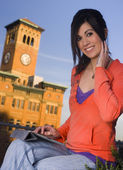 Woman Using a Tablet Outside — Stock Photo