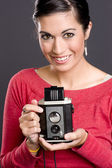 Pretty woman with vintage camera — Stock Photo