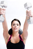 Attractive Active Brunette Woman Lifting Barbells Laying Flat on Bench — Stock Photo