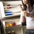 She gets Into Fridge — Stock Photo #12830455